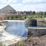 Custom built pool and landscaping by Mackie Brothers Pool