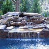 Backyard oasis with waterfall