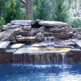 Backyard oasis with waterfall
