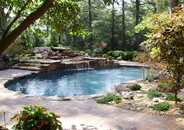 In ground pool with waterfall